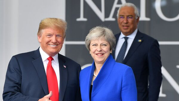 US President Donald Trump (L) gestures as he poses alongside Britain's Prime Minister Theresa May (R) as Portugal's Prime Minister Antonio Costa (TOP) looks on during the opening ceremony of the NATO (North Atlantic Treaty Organization) summit, at the NATO headquarters in Brussels, on July 11, 2018. - Sputnik International