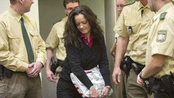 Beate Zschaepe, alleged member of the neo-Nazi group National Socialist Underground (NSU) enters a court room in Munich, southern Germany, Tuesday, June 4, 2013 - Sputnik International