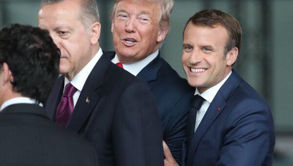 France's President Emmanuel Macron (R) jokes with US President Donald Trump (C) next to Turkey's President Recep Tayyip Erdogan as they arrive for the NATO (North Atlantic Treaty Organization) summit, at the NATO headquarters in Brussels, on July 11, 2018. - Sputnik International