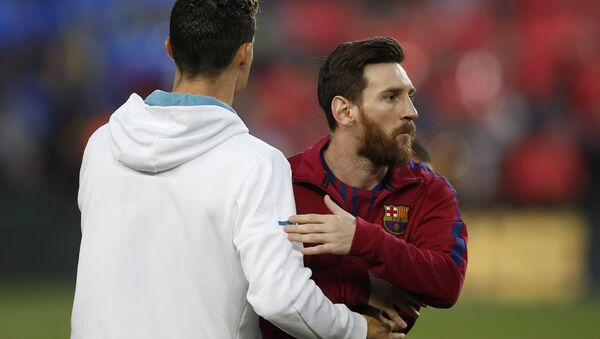 Barcelona's Lionel Messi, right and Real Madrid's Cristiano Ronaldo greets each other before a Spanish La Liga soccer match between Barcelona and Real Madrid, dubbed 'el clasico', at the Camp Nou stadium in Barcelona, Spain, Sunday, May 6, 2018 - Sputnik International