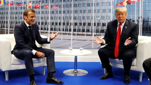 U.S. President Donald Trump meets with French President Emmanuel Macron during the NATO summit in Brussels, Belgium July 11, 2018 - Sputnik International