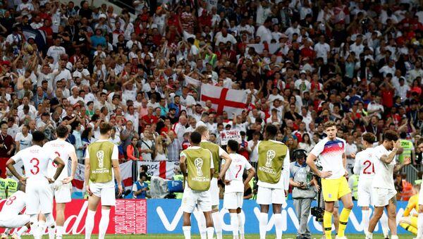 Soccer Football - World Cup - Semi Final - Croatia v England - Luzhniki Stadium, Moscow, Russia - July 11, 2018 England players look dejected as the England fans applaud them after the match - Sputnik International