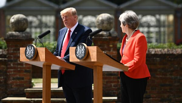 US President Donald Trump (L) and Britain's Prime Minister Theresa May hold a joint press conference following their meeting at Chequers, the prime minister's country residence, near Ellesborough, northwest of London on July 13, 2018 on the second day of Trump's UK visit - Sputnik International