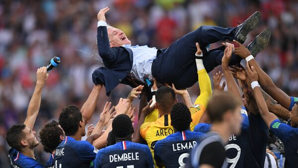 France's players and their head coach Didier Deschamps celebrate team's 4-2 victory in the World Cup final soccer match between France and Croatia at the Luzhniki stadium, in Moscow, Russia, July 15, 2018. - Sputnik International