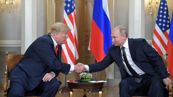 U.S. President Donald Trump meets with Russia's President Vladimir Putin in Helsinki, Finland, July 16, 2018 - Sputnik International