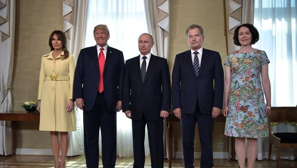 Russia's President Vladimir Putin (C), US President Donald Trump (2nd L), First lady Melania Trump (L), Finland's President Sauli Niinisto (2nd R) and his wife Jenni Haukio pose for a picture during a meeting in Helsinki, Finland July 16, 2018. - Sputnik International