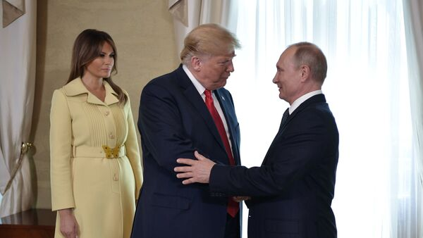Russia's President Vladimir Putin (R) greets U.S. President Donald Trump, as First lady Melania Trump stands nearby, during a meeting in Helsinki, Finland July 16, 2018 - Sputnik International