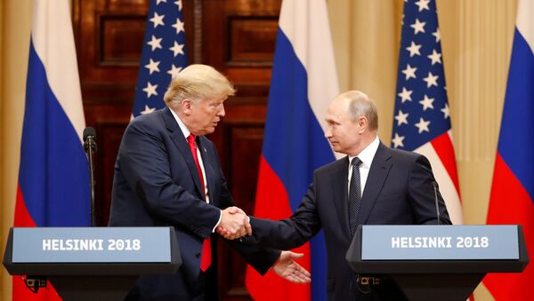 U.S. President Donald Trump and Russian President Vladimir Putin shake hands as they hold a joint news conference after their meeting in Helsinki, Finland July 16, 2018 - Sputnik International