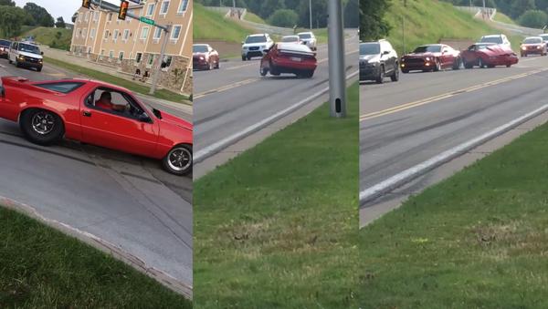 Dodge vs. Mustang: Motorist's Peel Out Attempt Takes Unexpected Turn - Sputnik International
