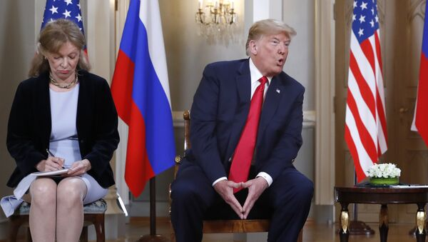 Interpreter interpreter Marina Gross, left, takes notes when U.S. President Donald Trump talks to Russian President Vladimir Putin at the beginning of their one-on-one-meeting at the Presidential Palace in Helsinki, Finland, Monday, July 16, 2018. - Sputnik International