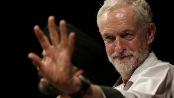 British lawmaker Jeremy Corbyn waves to a member of the audience prior to addressing a meeting during his election campaign for the leadership of the British Labour Party in Ealing, west London, Monday, Aug. 17, 2015 - Sputnik International