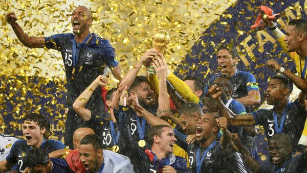 France's players celebrate with the Trophy after winning the World Cup final soccer match between France and Croatia at the Luzhniki stadium, in Moscow, Russia, July 15, 2018 - Sputnik International
