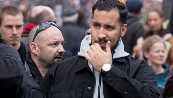 Alexandre Benalla, French presidential aide, is seen during the May Day labour union rally in Paris, France May 1, 2018. At L, Vincent Crase, employee of LREM - Sputnik International