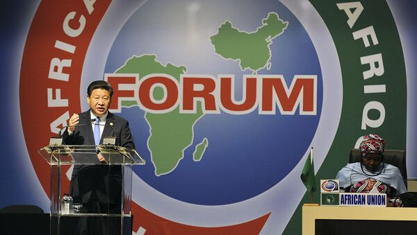 Dec. 4, 2015 file photo, Chinese President Xi Jinping, left, delivers his speech during the opening ceremony of the Johannesburg Summit for the Forum on China-Africa Cooperation at the Sandton Convention Centre in Johannesburg - Sputnik International