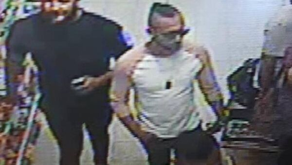 Police issued this image of three men they would like to speak to about the suspected acid attack - Sputnik International
