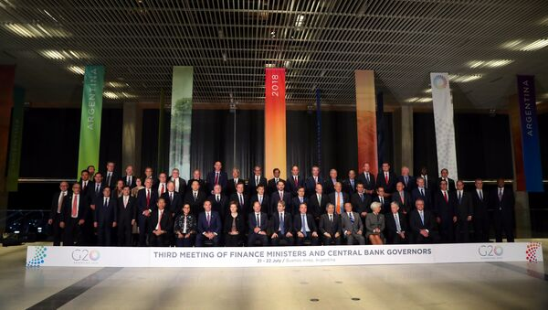 Finance ministers and Central Bank presidents pose for the official photo at the G20 Meeting of Finance Ministers in Buenos Aires, Argentina, July 21, 2018 - Sputnik International