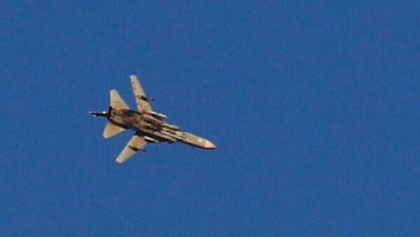 A war jet flies above Syria near the Israeli Syrian border as it is seen from the Israeli-occupied Golan Heights, Israel July 23, 2018 - Sputnik International