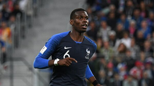 France's Paul Pogba runs during the World Cup semifinal soccer match between France and Belgium at the Saint Petersburg Stadium, in St.Petersburg, Russia, July 10, 2018 - Sputnik International