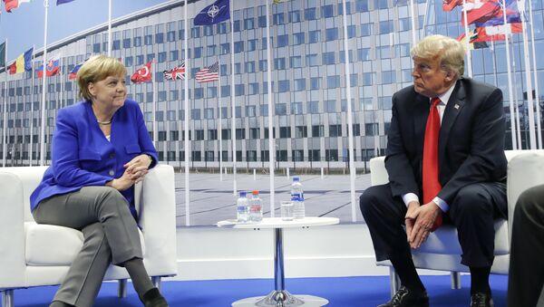 President Donald Trump and German Chancellor Angela Merkel during their bilateral meeting, Wednesday, July 11, 2018 in Brussels, Belgium - Sputnik International