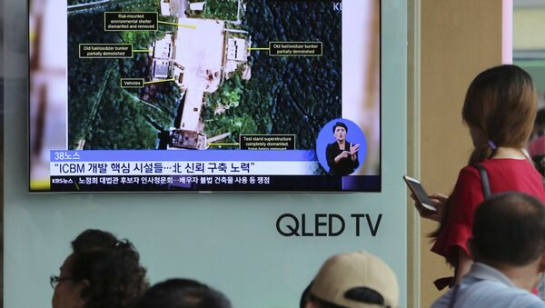 A TV screen shows a satellite image of North Korea's Sohae launch site, during a news program at the Seoul Railway Station in Seoul, South Korea, Tuesday, July 24, 2018. - Sputnik International