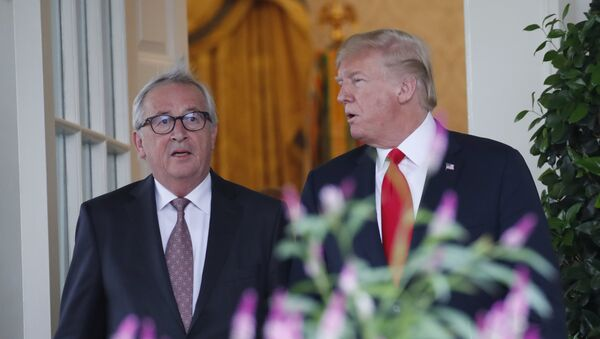 President Donald Trump, right, and European Commission president Jean-Claude Juncker arrive to speak in the Rose Garden of the White House, Wednesday, July 25, 2018, in Washington - Sputnik International