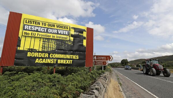 Anti-Brexit billboards are seen on the northern side of the border between Newry, in Northern Ireland, and Dundalk, in the Republic of Ireland, on Wednesday, July 18, 2018. - Sputnik International