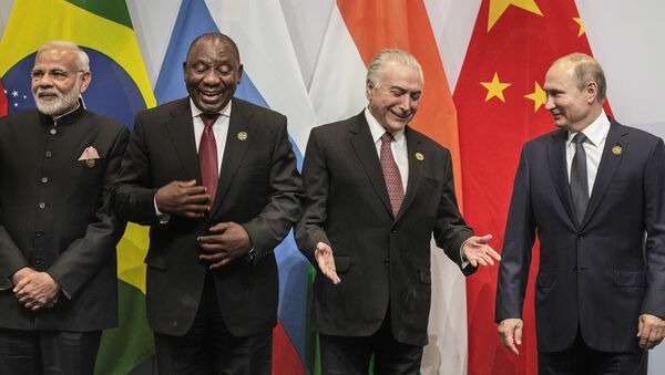 From left, Indian Prime Minister Narendra Modi, South African President Cyril Ramaphosa, Brazil's President Michel Temer and Russia's President Vladimir Putin, get ready for a group photo at the BRICS Summit in Johannesburg, South Africa, Thursday, July 26, 2018. Putin arrived in South Africa Thursday, the last head of state to arrive for the Summit - Sputnik International
