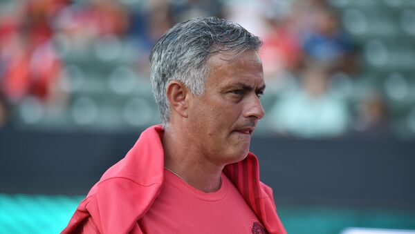 Manchester United's coach Jose Mourinho walks on the pitch before the start of the International Champions Cup match between Manchester United and AC Milan at the StubHub Center in Carson, California, on July 25, 2018 - Sputnik International