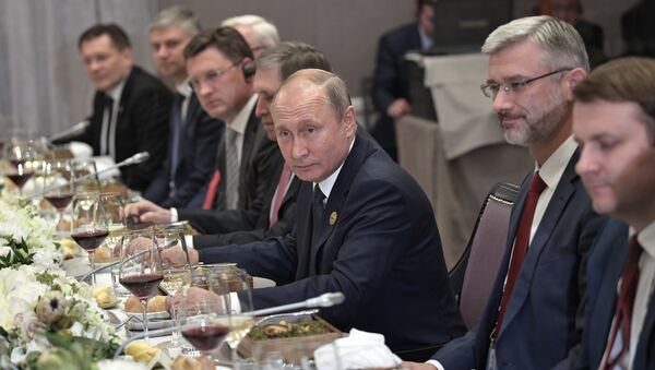 July 26, 2018. Russian President Vladimir Putin during a working dinner with President of China Xi Jinping on the sidelines of the 10th BRICS Summit in Johannesburg - Sputnik International