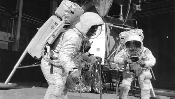 Two members of the Apollo 11 lunar landing mission participate in a simulation of deploying and using lunar tools on the surface of the Moon during a training exercise on April 22, 1969 - Sputnik International