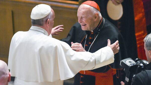 In this Sept. 23, 2015 file photo, Pope Francis reaches out to hug Cardinal Archbishop emeritus Theodore McCarrick after the Midday Prayer of the Divine with more than 300 U.S. Bishops at the Cathedral of St. Matthew the Apostle in Washington. Pope Francis has accepted U.S. prelate Theodore McCarrick's offer to resign from the College of Cardinals following allegations of sexual abuse, including one involving an 11-year-old boy, and ordered him to conduct a life of prayer and penance in a home to be designated by the pontiff until a church trial is held, the Vatican said Saturday - Sputnik International