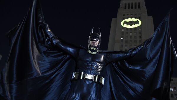 Caeser Saend, of Los Angeles, poses in front of a Bat-Signal projected onto City Hall at a tribute to Batman star Adam West on Thursday, June 15, 2017, in Los Angeles - Sputnik International