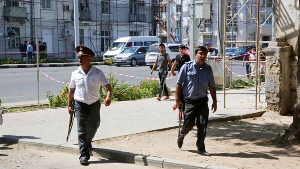 Police officers secure an area in the capital of Tajikistan, Dushanbe, where several Interior Ministry special forces officers and a traffic policeman were reportedly shot dead earlier on Friday, Sept. 4, 2015. - Sputnik International