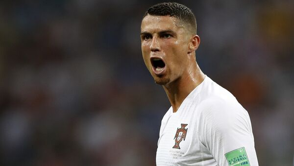 In this file photo dated Saturday, June 30, 2018, Portugal's Cristiano Ronaldo reacts during the round of 16 match between Uruguay and Portugal during the 2018 soccer World Cup at the Fisht Stadium in Sochi, Russia. Cristiano Ronaldo is leaving Real Madrid it is announced Tuesday July 10, 2018, to join Italian club Juventus, bringing to an end a hugely successful nine-year spell in Spain - Sputnik International