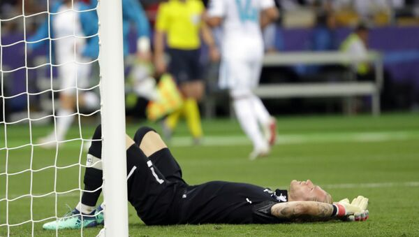 In this May 26, 2018, file photo, Liverpool goalkeeper Loris Karius reacts after Real Madrid's Gareth Bale scored during the Champions League final soccer match at the Olimpiyskiy Stadium in Kiev, Ukraine. Doctors based in Boston have concluded Karius sustained a concussion during last month's Champions League final that would have affected his performance - Sputnik International