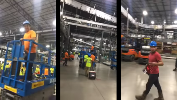 Viral video shows man jubilantly celebrating fellow workers' wildcat strike. - Sputnik International