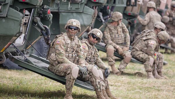 American soldiers are seen during NATO Saber Strike military exercises on June 16, 2017 in Orzysz, Poland - Sputnik International