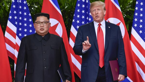 FILE - In this June 12, 2018, file photo, U.S. President Donald Trump makes a statement before saying goodbye to North Korea leader Kim Jong Un after their meetings at the Capella resort on Sentosa Island in Singapore - Sputnik International