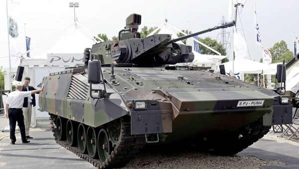 A German S Pz Puma equipped with an effective vision concept and a 30mm Mauser canon is on display at the Eurosatory arms show, in Villepinte, outside Paris, Wednesday, June 14, 2006. Several tank makers said the Iraq war has provided a welcome injection of ideas and cash for research into future tanks. - Sputnik International