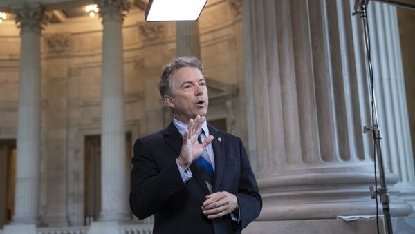 During a TV news interview, Sen. Rand Paul, R-Ky., defends President Donald Trump and his Helsinki news conference with Russian President Vladimir Putin whereTrump appeared to cast doubt on U.S. intelligence findings that Russia interfered in the 2016 election, on Capitol Hill in Washington, Tuesday, July 17, 2018 - Sputnik International