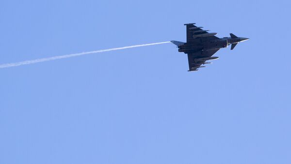Spain's Eurofighter Typhoon jet fighter flies during the military exercise over Rukla military base some 120 km. - Sputnik International