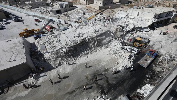 Destroyed buildings are seen on August 12, 2018 following an explosion at an arms depot in a residential area in Syria's northern Idlib province city of Sarmada in which 12 people were reportedly killed. - Sputnik International