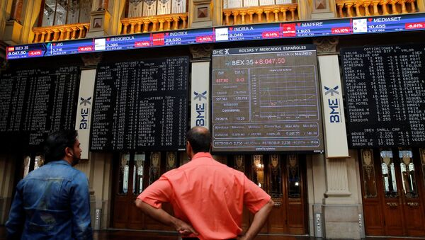 Electronic boards are seen at the Madrid stock exchange which plummeted after Britain voted to leave the European Union in the EU BREXIT referendum, in Madrid, Spain, June 24, 2016. - Sputnik International