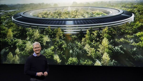 Apple CEO Tim Cook, discusses the new Apple campus at an event to announce new products at Apple headquarters Monday, March 21, 2016, in Cupertino, Calif. - Sputnik International