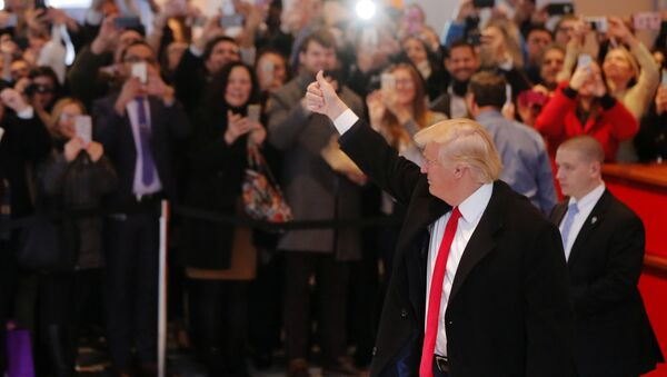 U.S. President elect Donald Trump reacts to a crowd gathered in the lobby of the New York Times building after a meeting in New York - Sputnik International