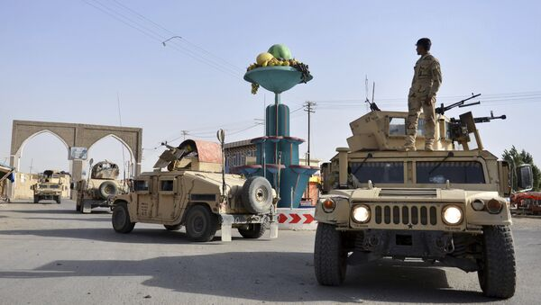 In this Sunday, Aug. 12, 2018, photo, Afghan security personnel patrol in the city of Ghazni province west of Kabul, Afghanistan. - Sputnik International