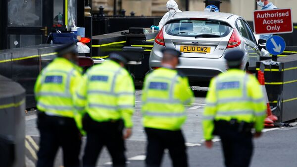 Forensic investigators work at the site after a car crashed outside the Houses of Parliament in Westminster, London, Britain, August 14, 2018 - Sputnik International