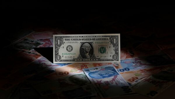 A U.S. dollar banknote is seen on top of Turkish lira banknotes in this picture illustration in Istanbul, Turkey August 14, 2018 - Sputnik International