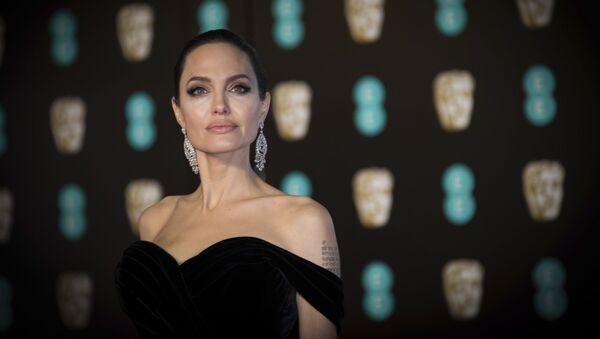 Angelina Jolie poses for photographers upon arrival at the BAFTA Film Awards, in London, Sunday, 18 February 2018.  - Sputnik International