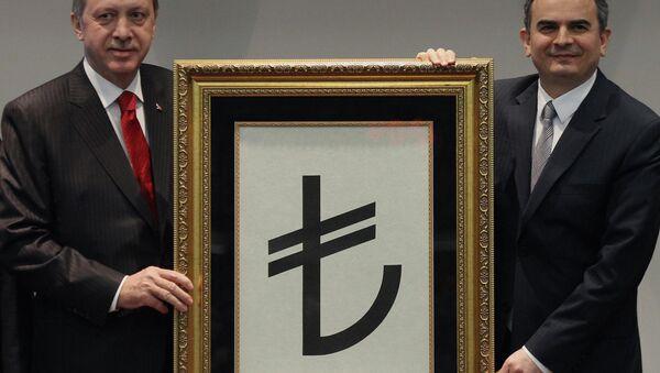 Turkish Prime Minister Recep Tayyip Erdogan, left, and Central Bank Governor Erdem Basci show the symbol for the national currency, the Turkish lira, in Ankara, Turkey, Thursday, March 1, 2012 - Sputnik International